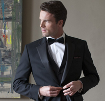 Brook Taverner model displaying a range of formal wear from Brook Taverner